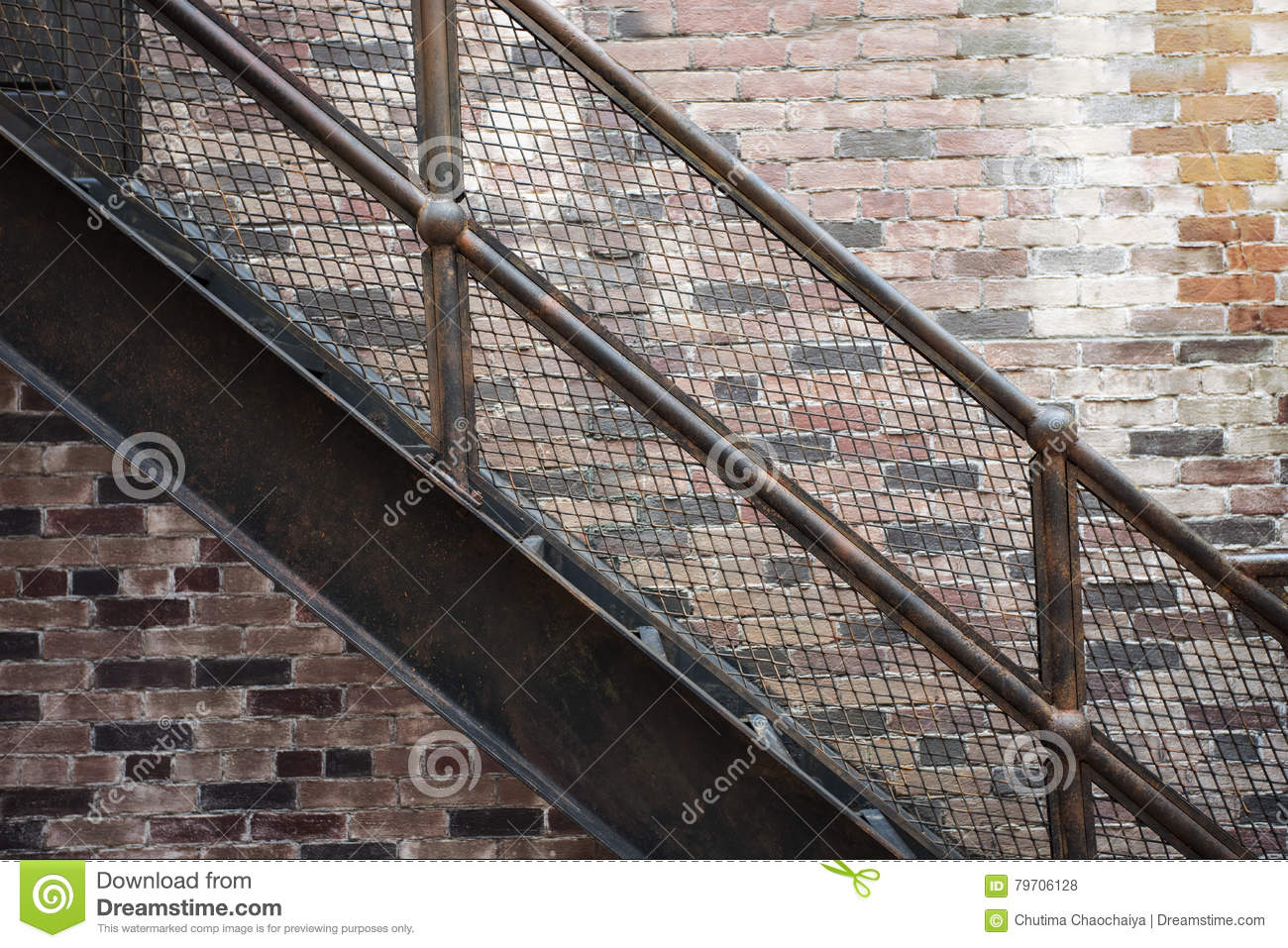 Stairs With Iron Railing And Old Brick Wall Stock Photo