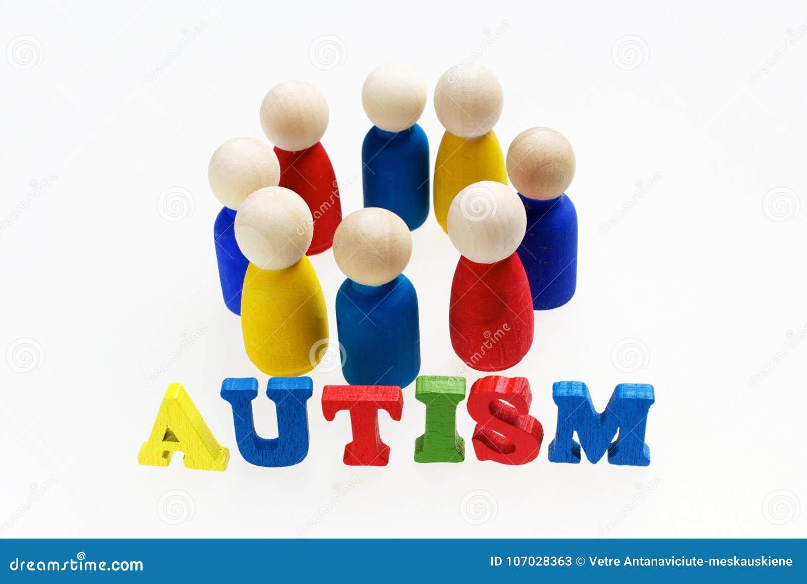 Iscrizione di autismo con le figure e su fondo bianco