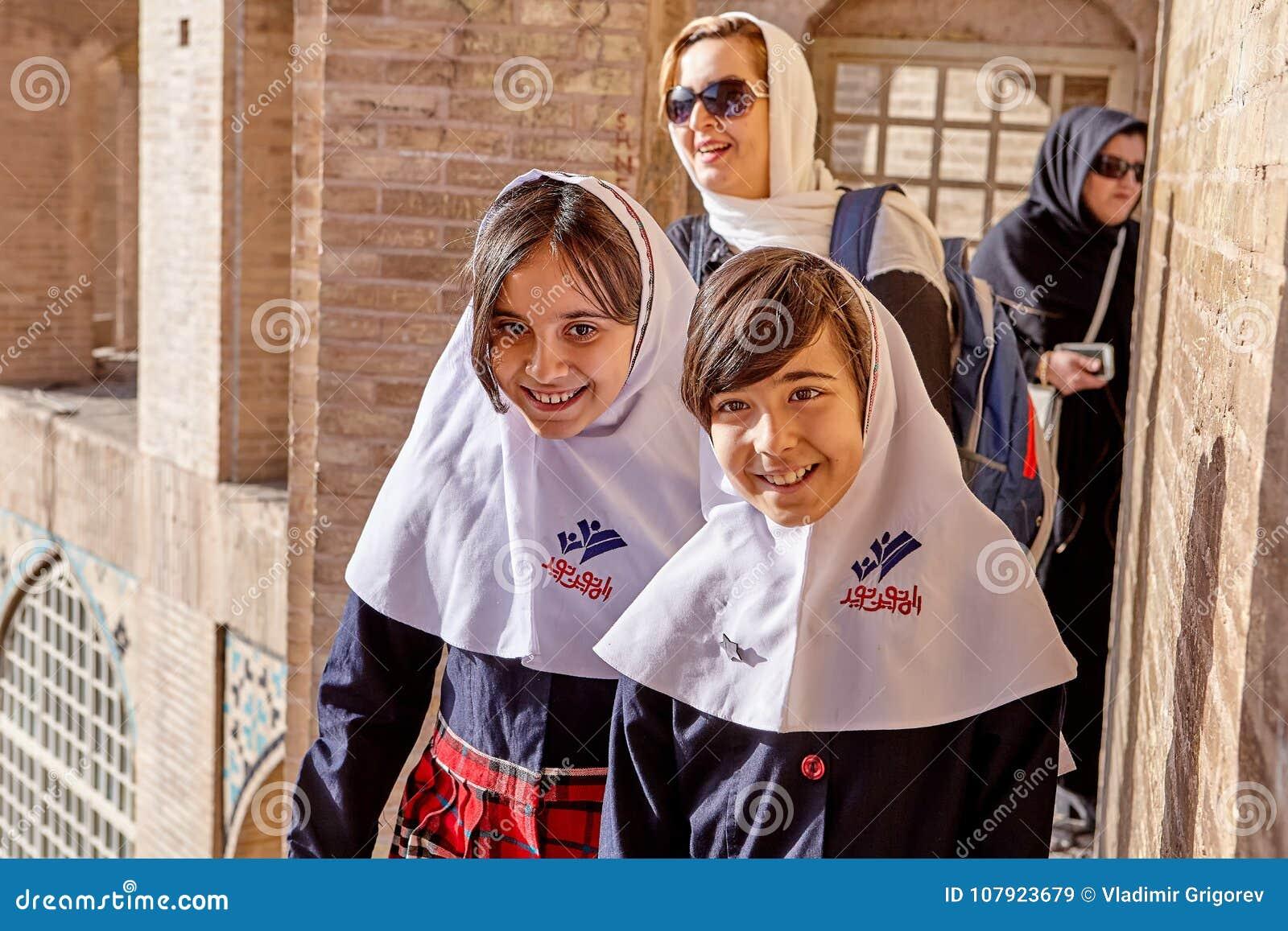 b307f7283df9 Iranian Girls In School Uniform Smiling On Sunny Day