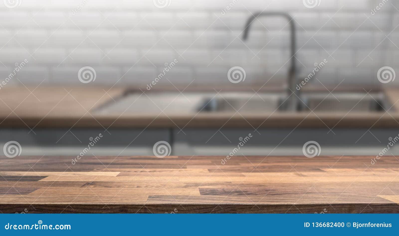 Isla de cocina con la sobremesa de madera para el montaje de la exhibición del producto