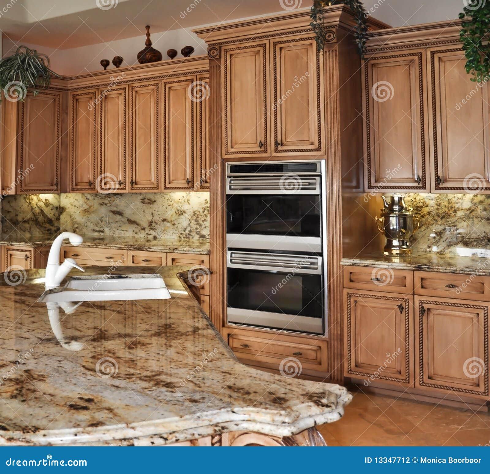 Granitos de cocina cocina con los gabinetes y los - Granito para cocina ...