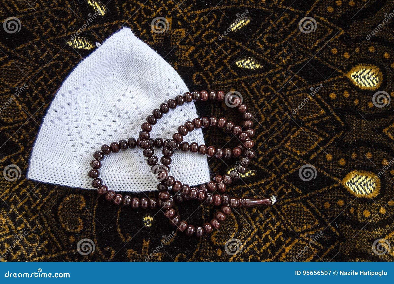 Islam y rezo a rogar, a rogar y alfombra de la manta de rezo,