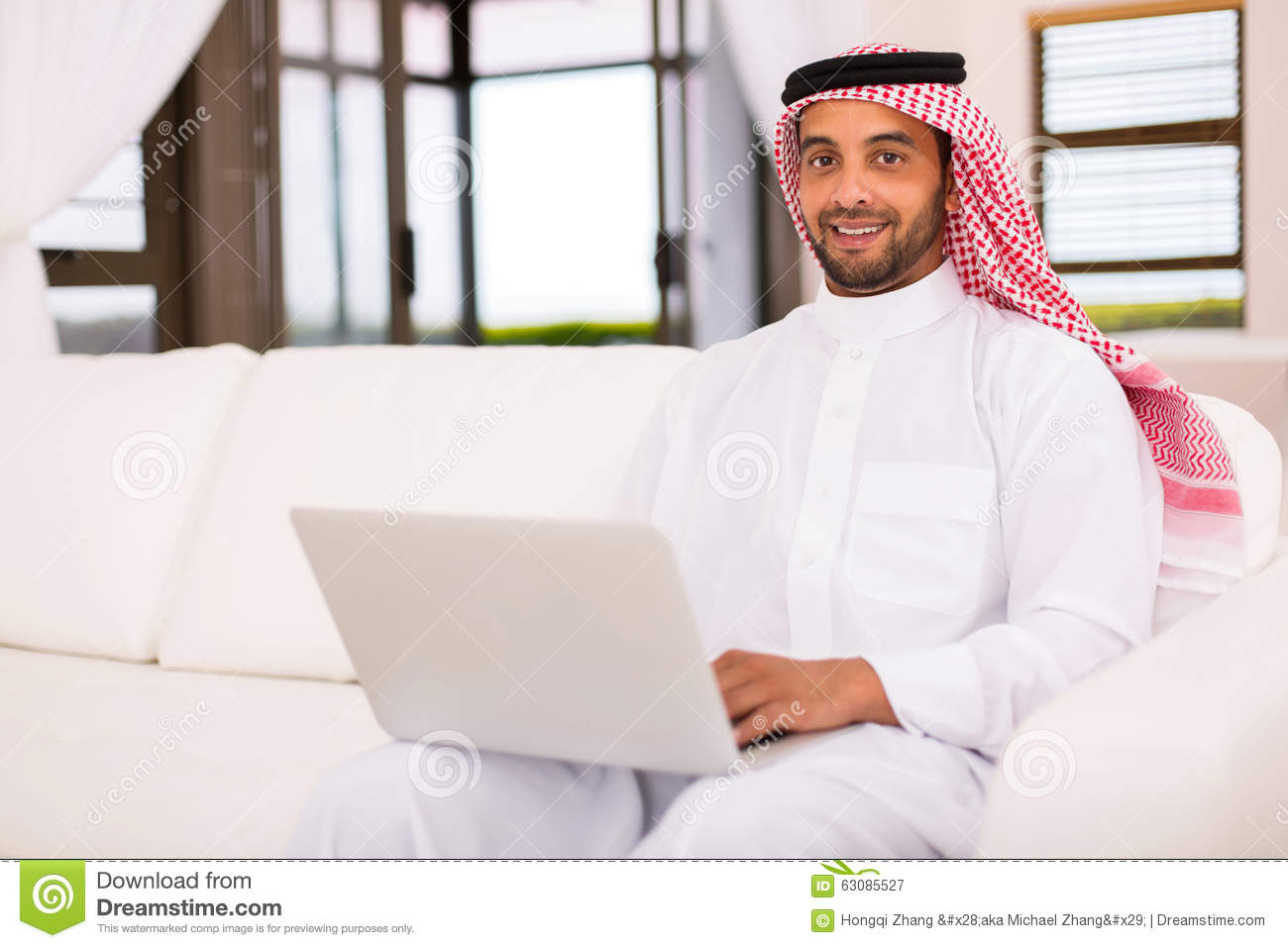 Happy Mature Islamic Man Holding Gun Over White Background Stock ...