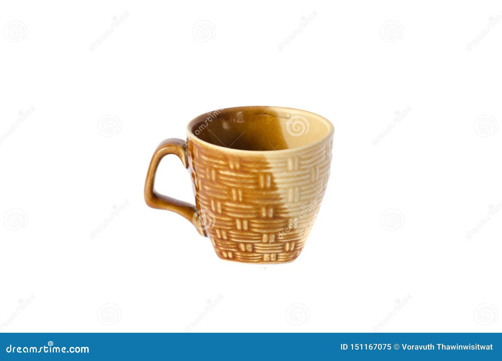 Isolat en céramique de tasse sur le fond blanc