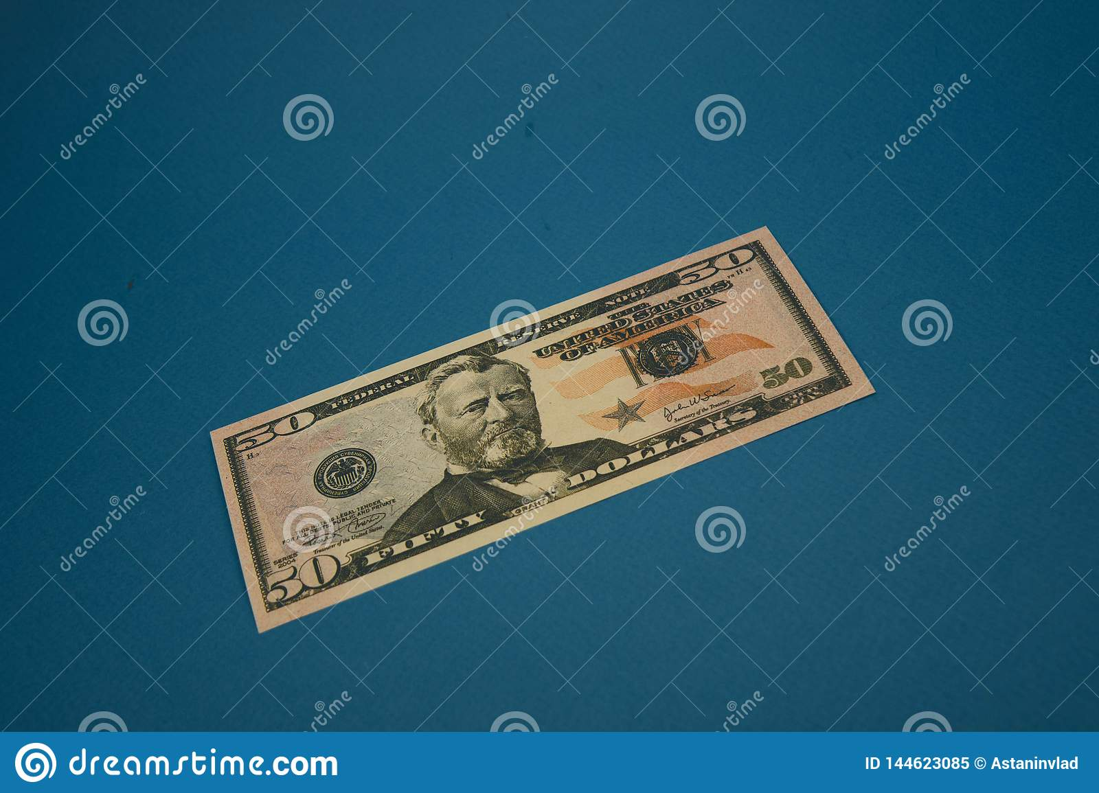 Isolated american fifty dollar bill on blue background