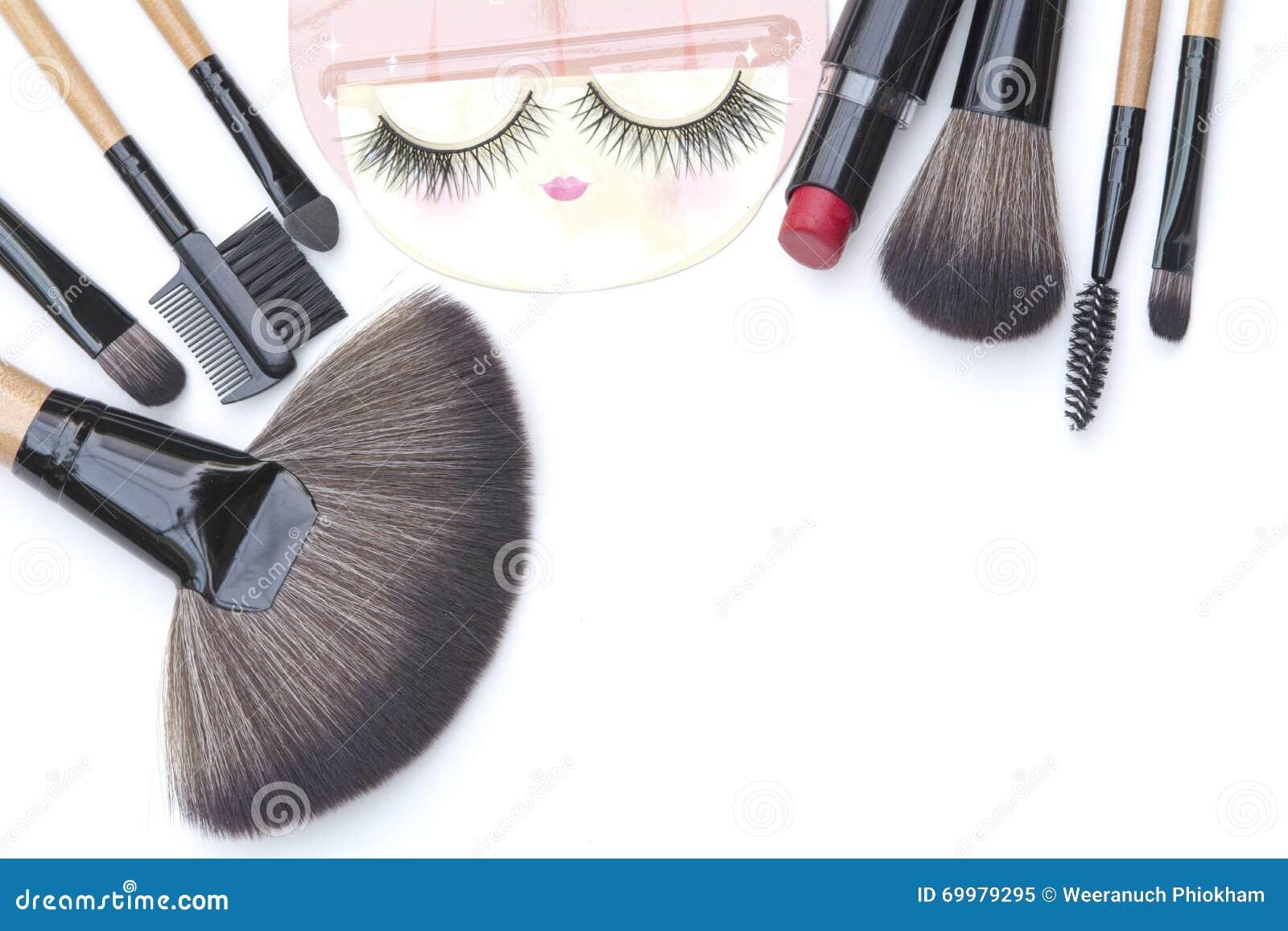 Isolated beautiful makeup brushes ,eyelash and red lipstick backgrounds