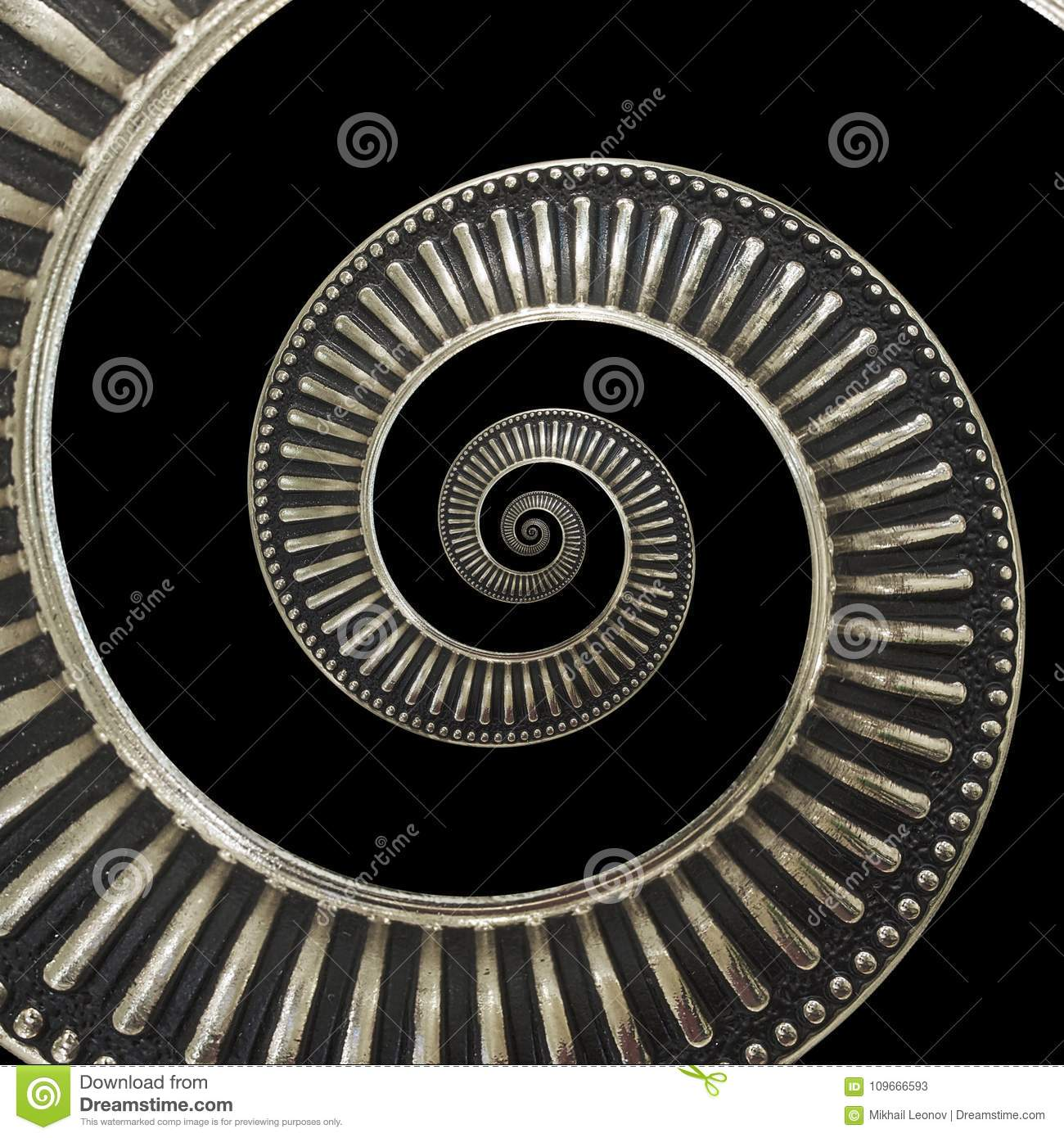 Isolated on black metal abstract spiral background pattern fractal. Metallic background, repetitive pattern. Metal spiral decorati