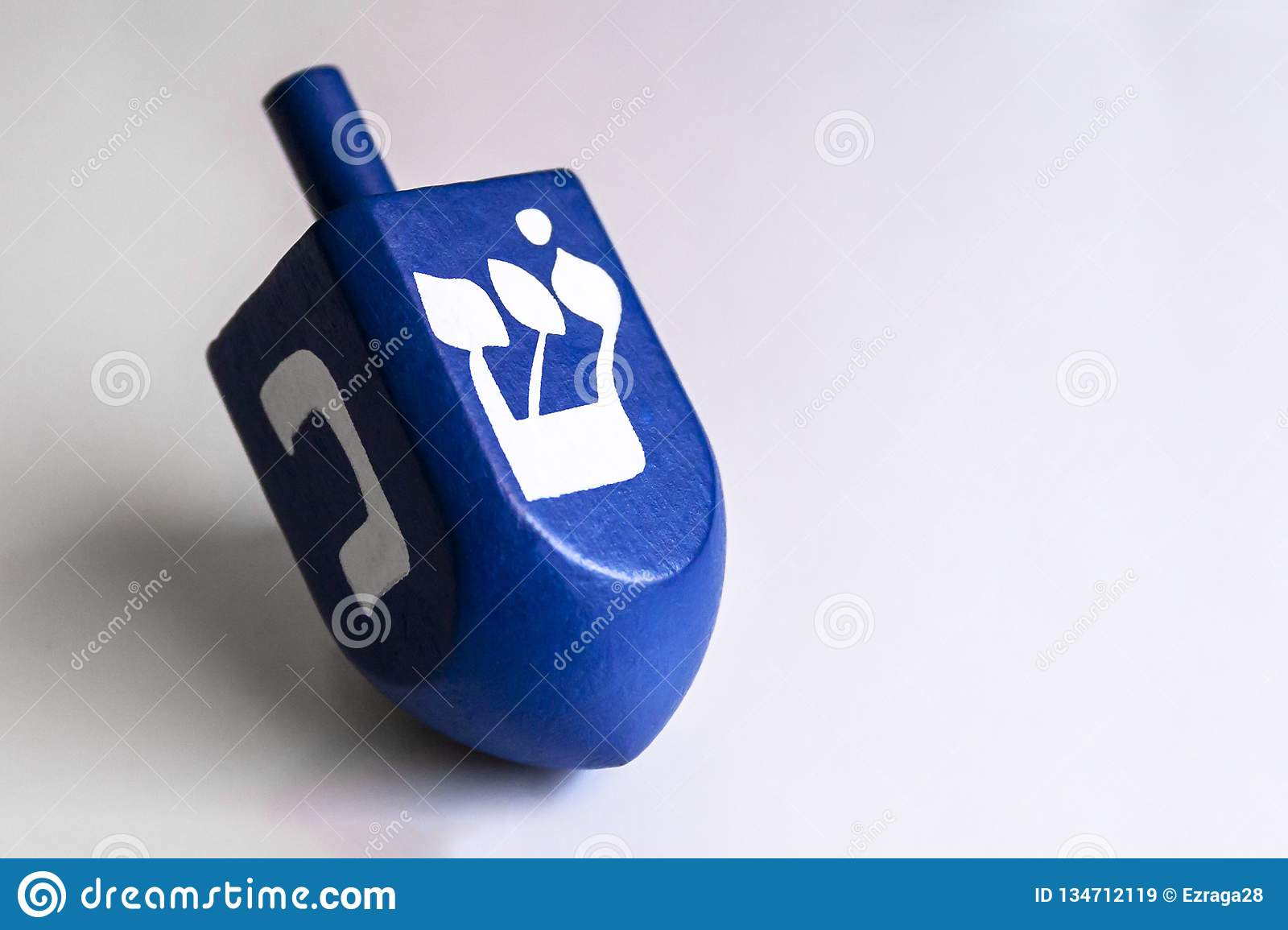 Isolated blue dreidel in a white background