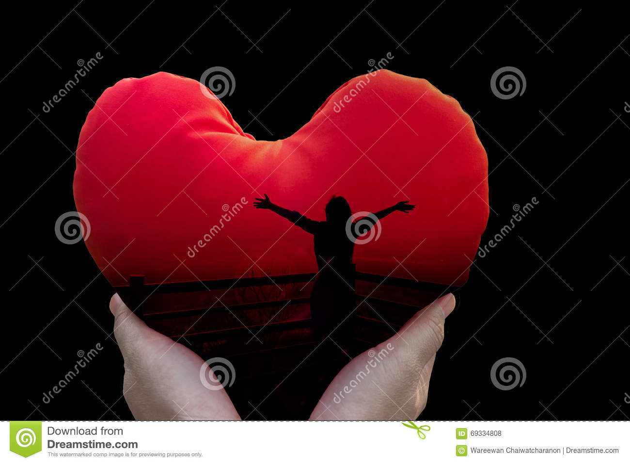 Isolated freedom silhouette women in red heart on black background in hands