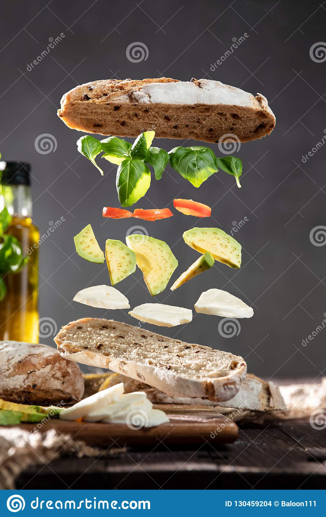 Isolated ingredients for a sandwich floating in air