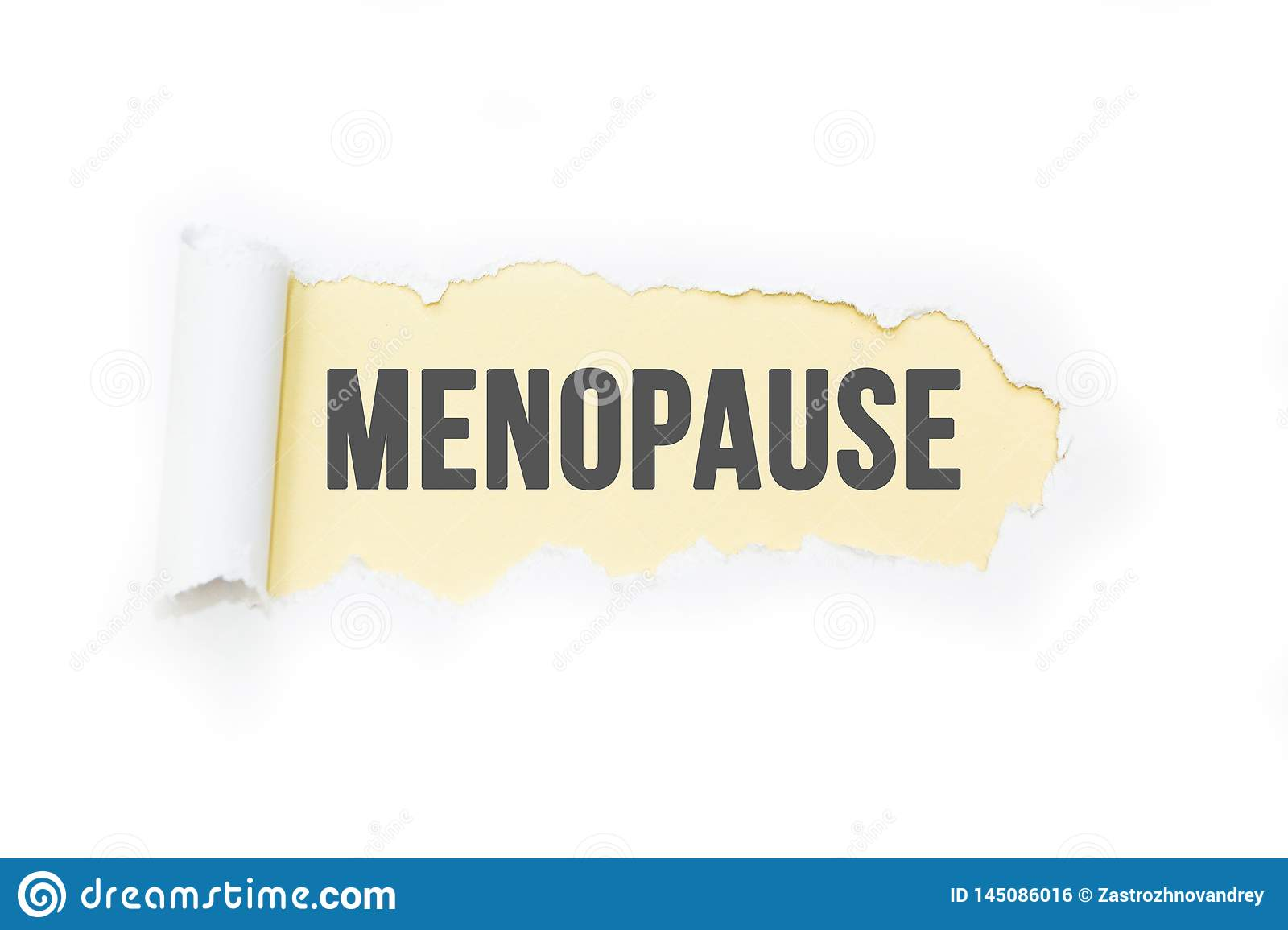 Isolated inscription `menopause` on a yellow background, tearing paper.