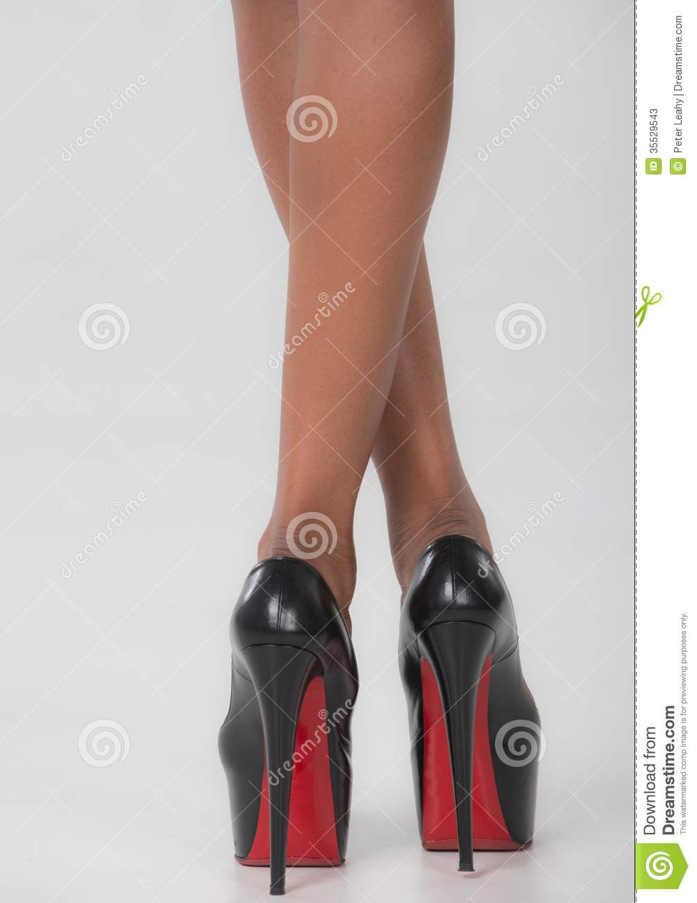 isolated legs and high heel shoes stock photos