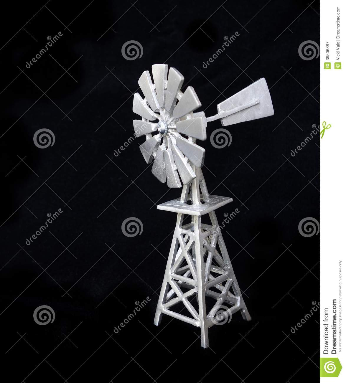 Isolated Pewter Windmill On Black Background.