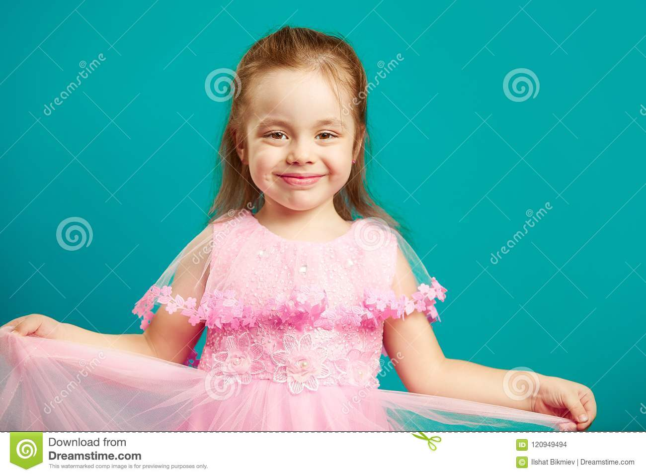 962de73b6a74 Baby Girl In Beautiful Pink Dress On Blue Isolated Stock Photo ...