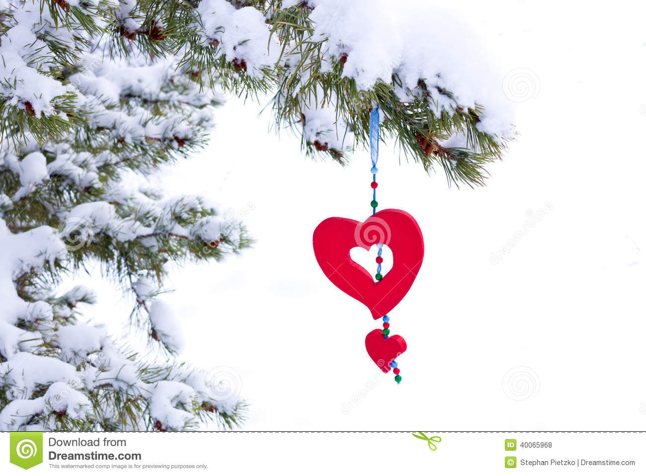 Isolated snowy christmas tree red heart decoration stock