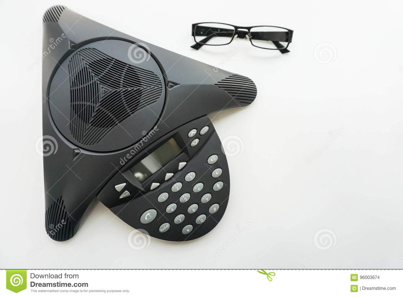Isolated Top View Of Voip Ip Conference Phone With Eye Glasses On