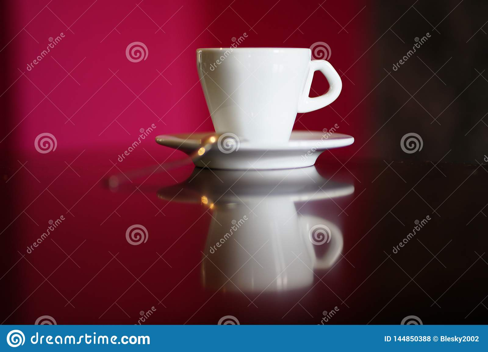 Isolated white coffee cup with plate and spoon