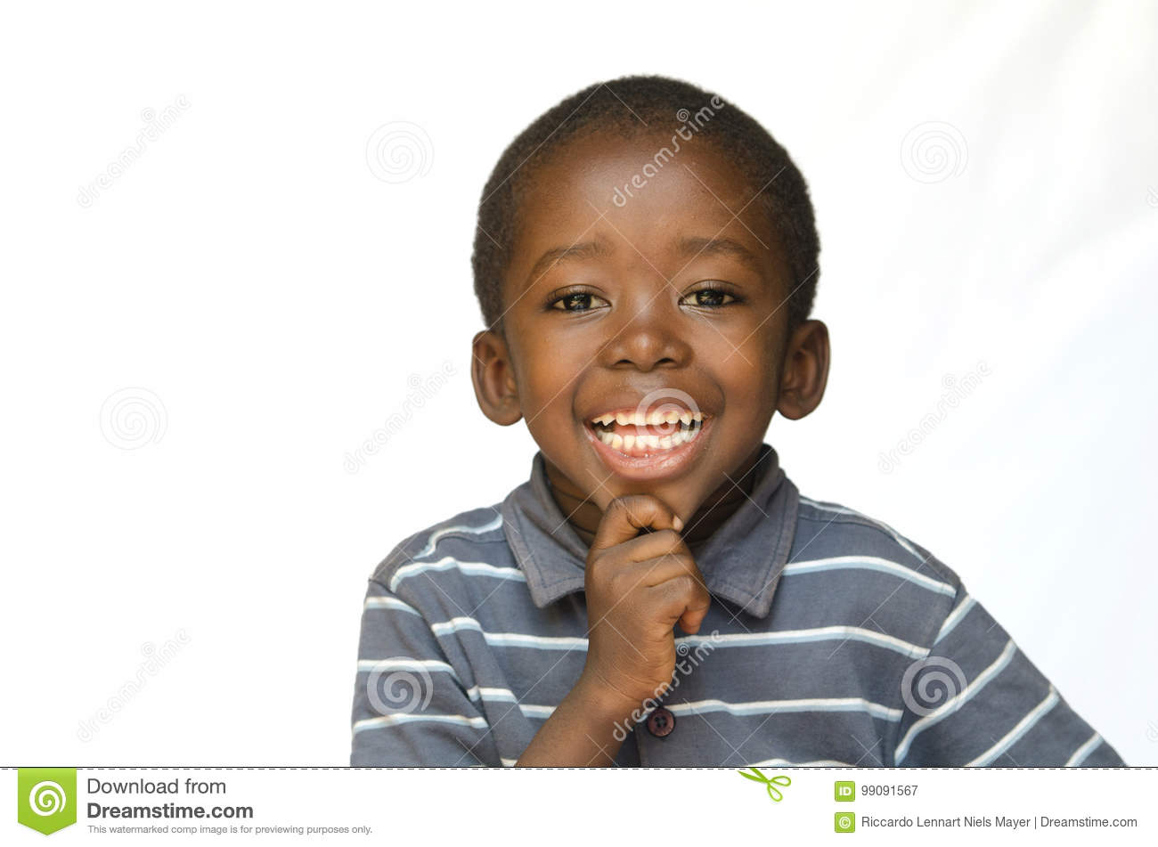 Portrait of African black boy child smiling with toothy smile isolated on white