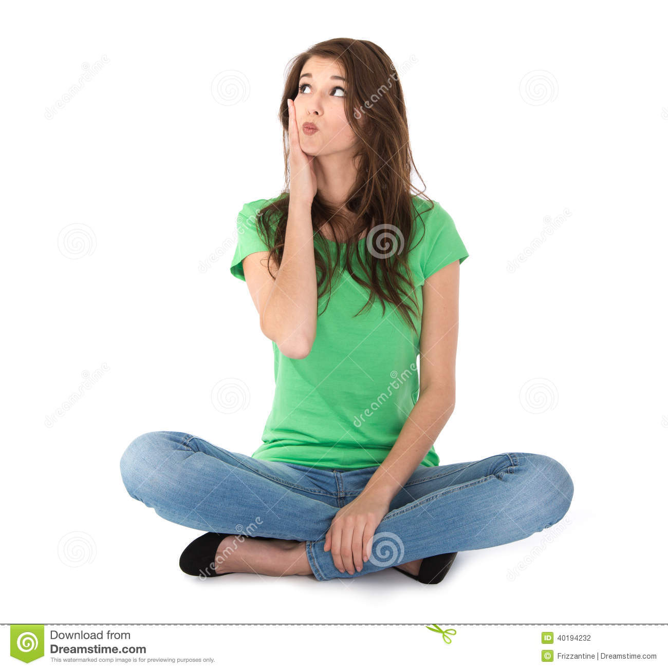 Casual Young Woman Sitting Legs Crossed Stock Photo