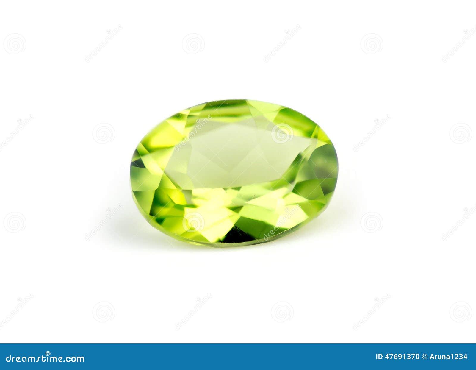 Isolato verde naturale brillante del peridot su bianco