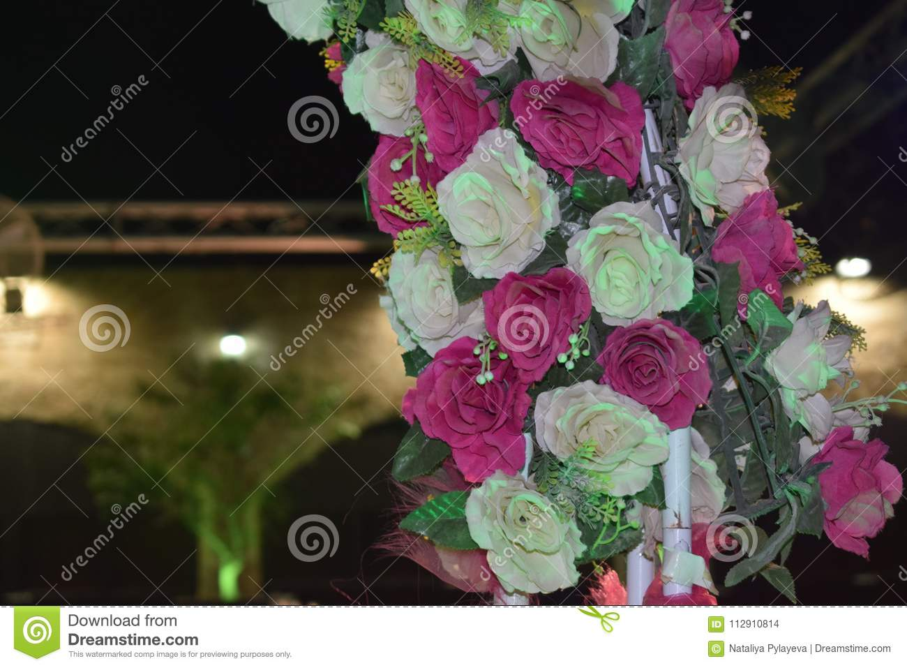 Decorative Arch Of Pink Flowers For A Wedding Night Stock Photo