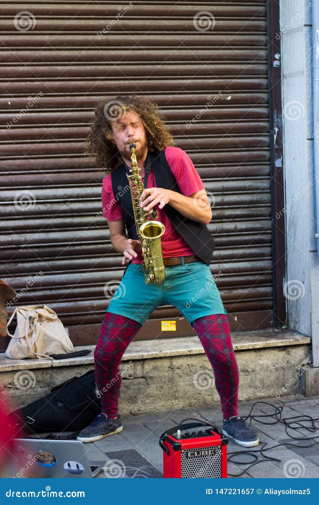 Istanbul, Istiklal Street / Turkey 9.5.2019: Street Musician Performing Saxophone in the Istiklal Street