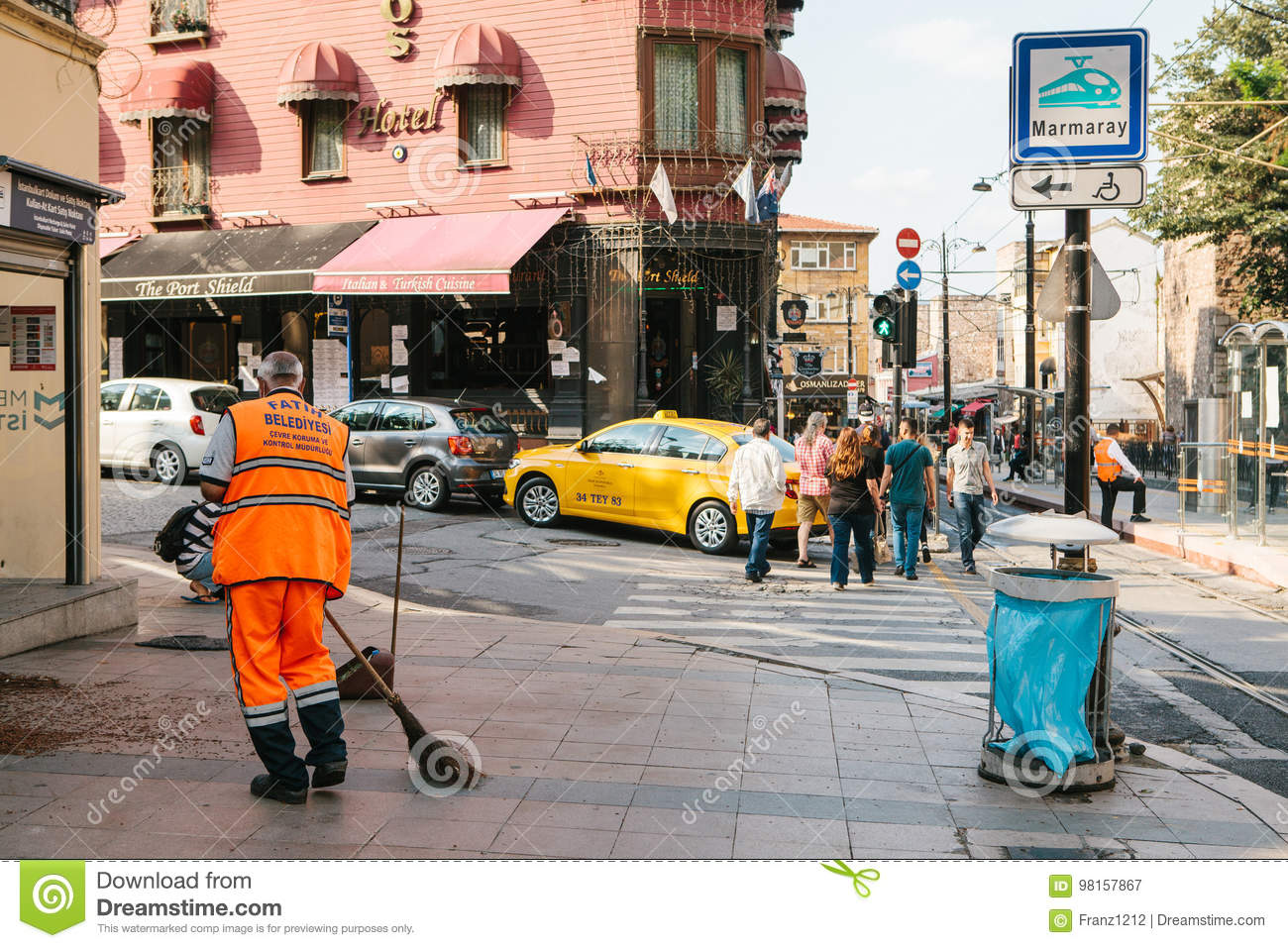 3d Orange Man Sweeping With Broom Stock Photography