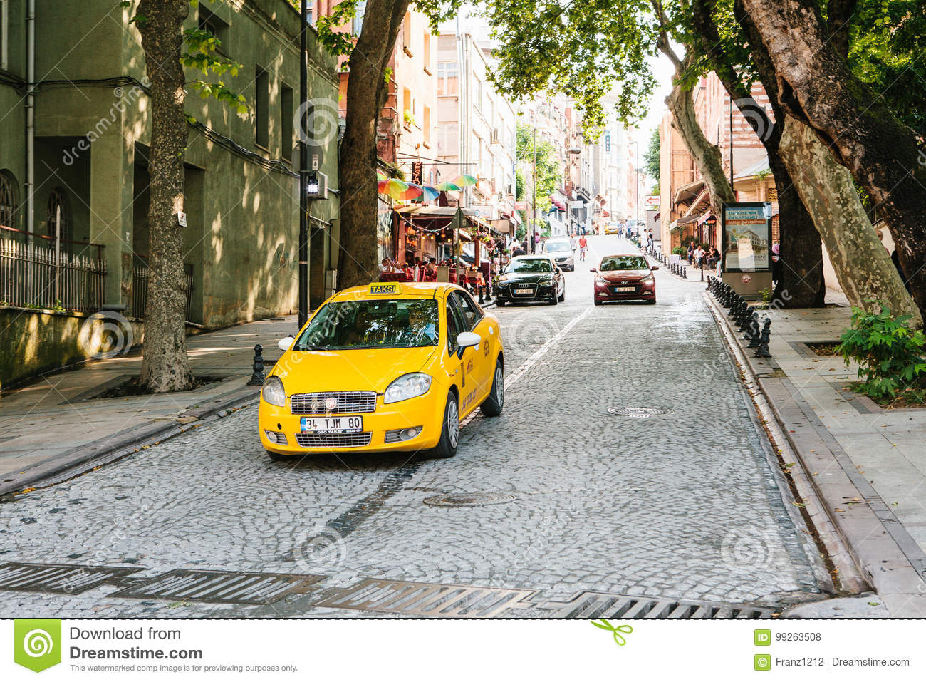 Istanbul, June 15, 2017: A Traditional Yellow Taxi Rides On