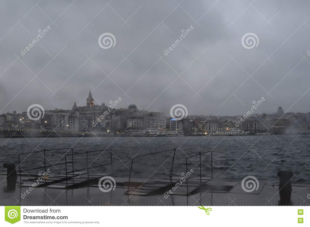 Istanbul, misty rain on a cold winter morning. Galata Tower and