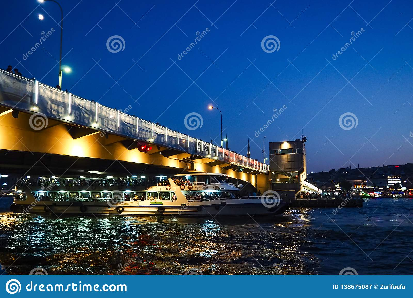 ISTANBUL, TURKEY - AUGUST 21, 2018: ferry under Galata bridge