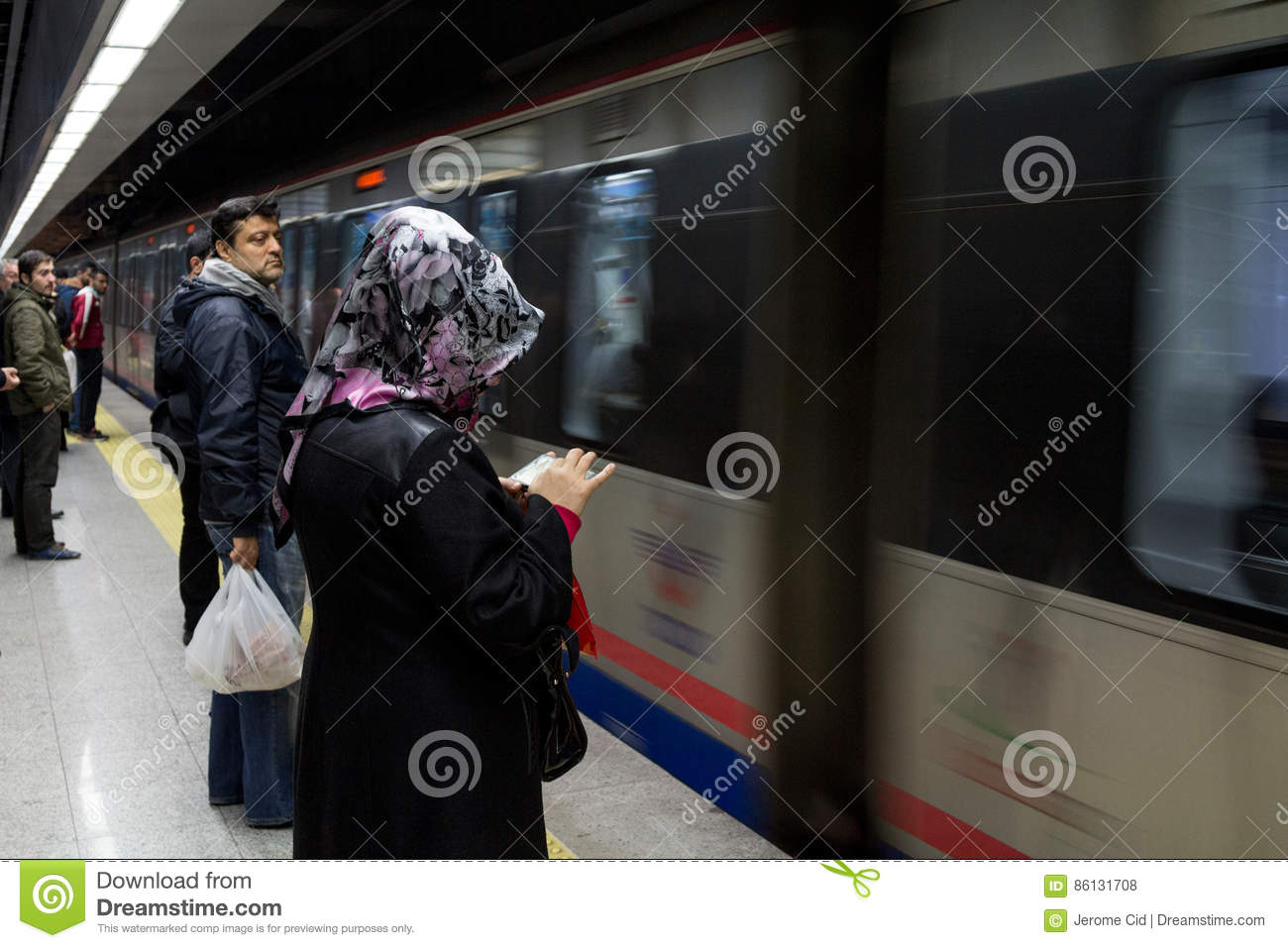 ISTANBUL, TURKEY - DECEMBER 28, 2015 : People waiting to board a Marmaray train.