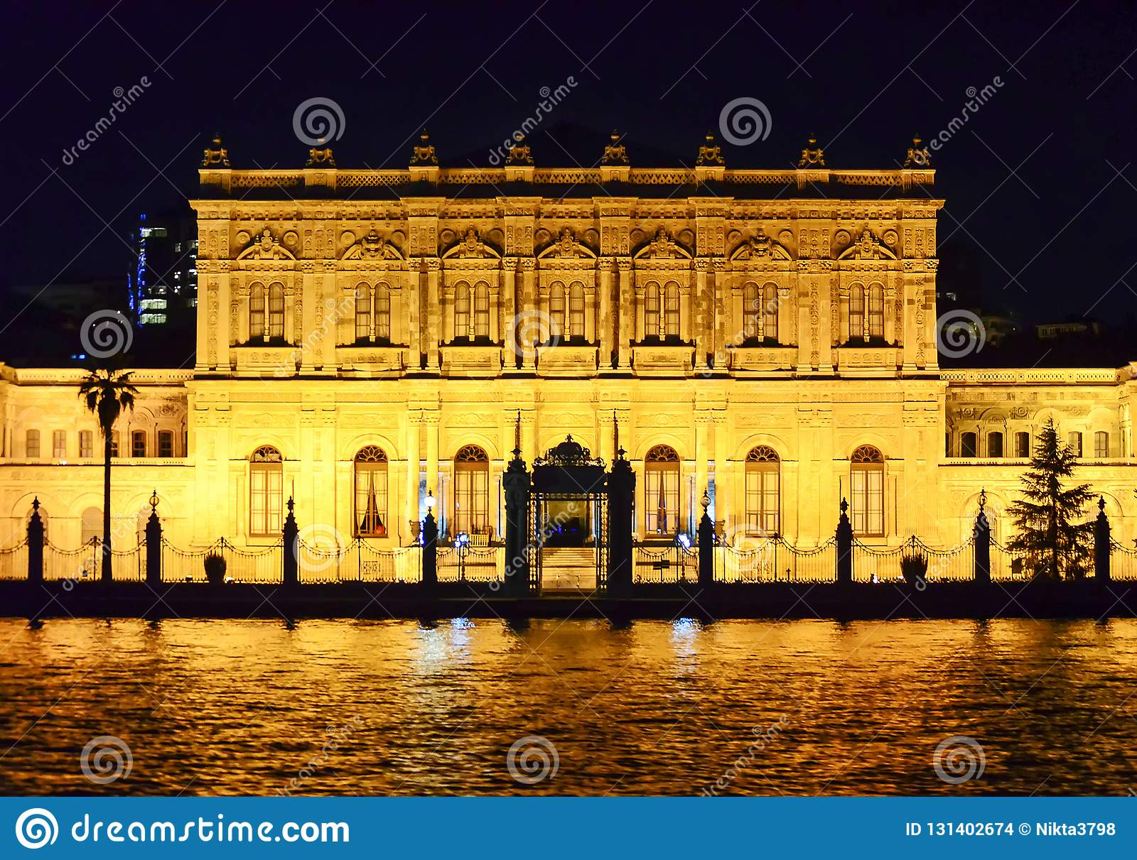 Istanbul, TURKEY September 19 - 2018. Dolmabahce palace seen from the water at night