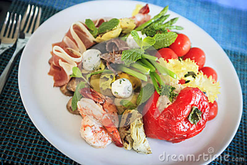 of antipasto. A mixture of prosciutto, shimps, bocconcini, grilled ...