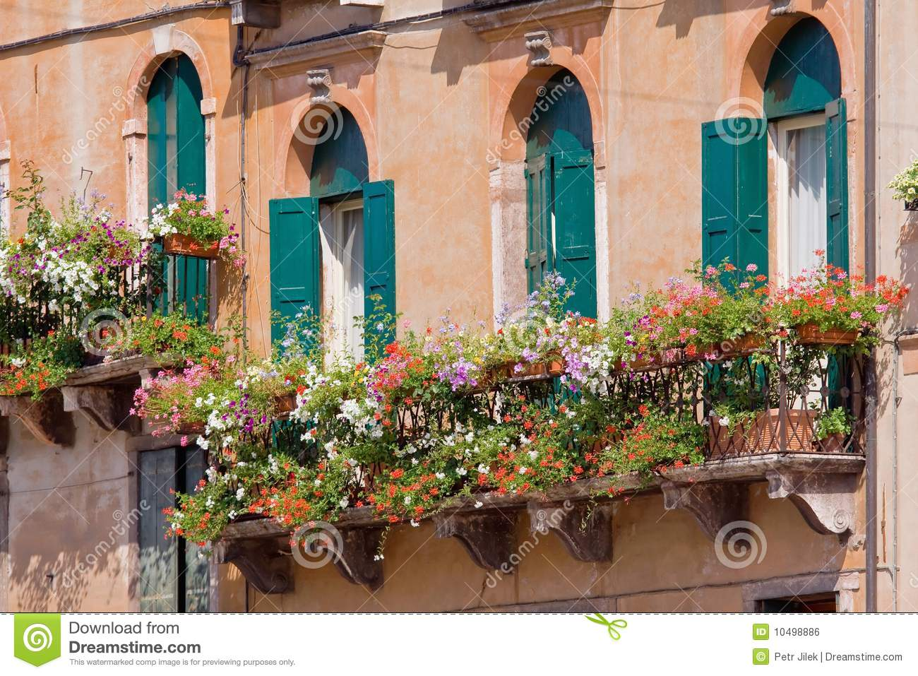 Italian balcony with flowerpots and flowers royalty free for Balcony in italian