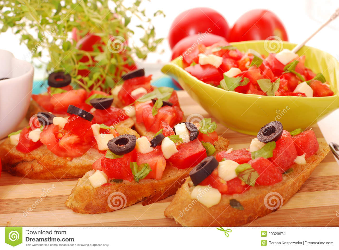 ... bruschetta with fresh tomato,basil,mozzarella and black olives