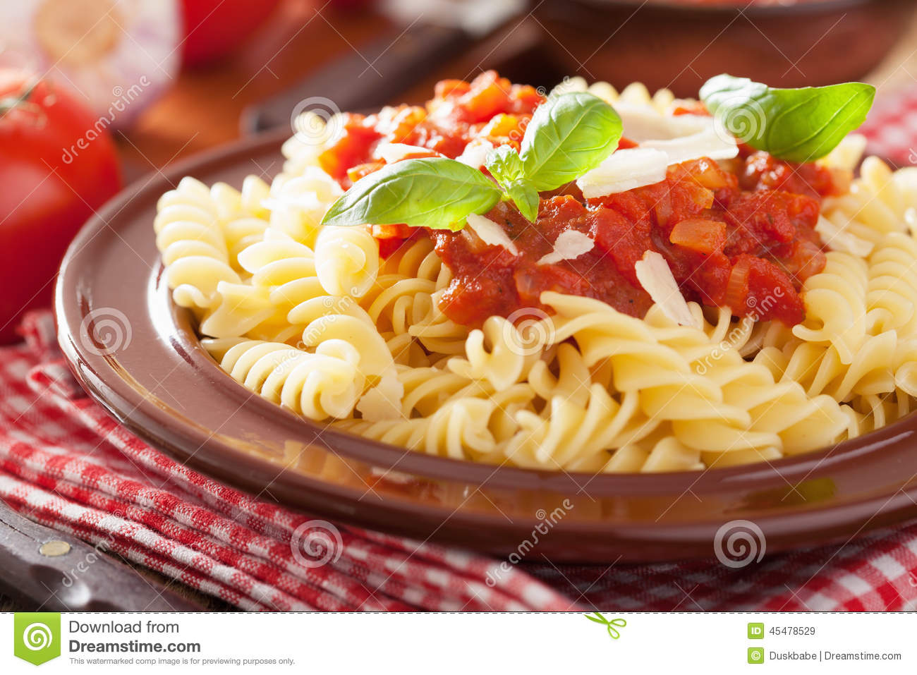 Italian Classic Pasta Fusilli With Tomato Sauce And Basil Stock Photo ...