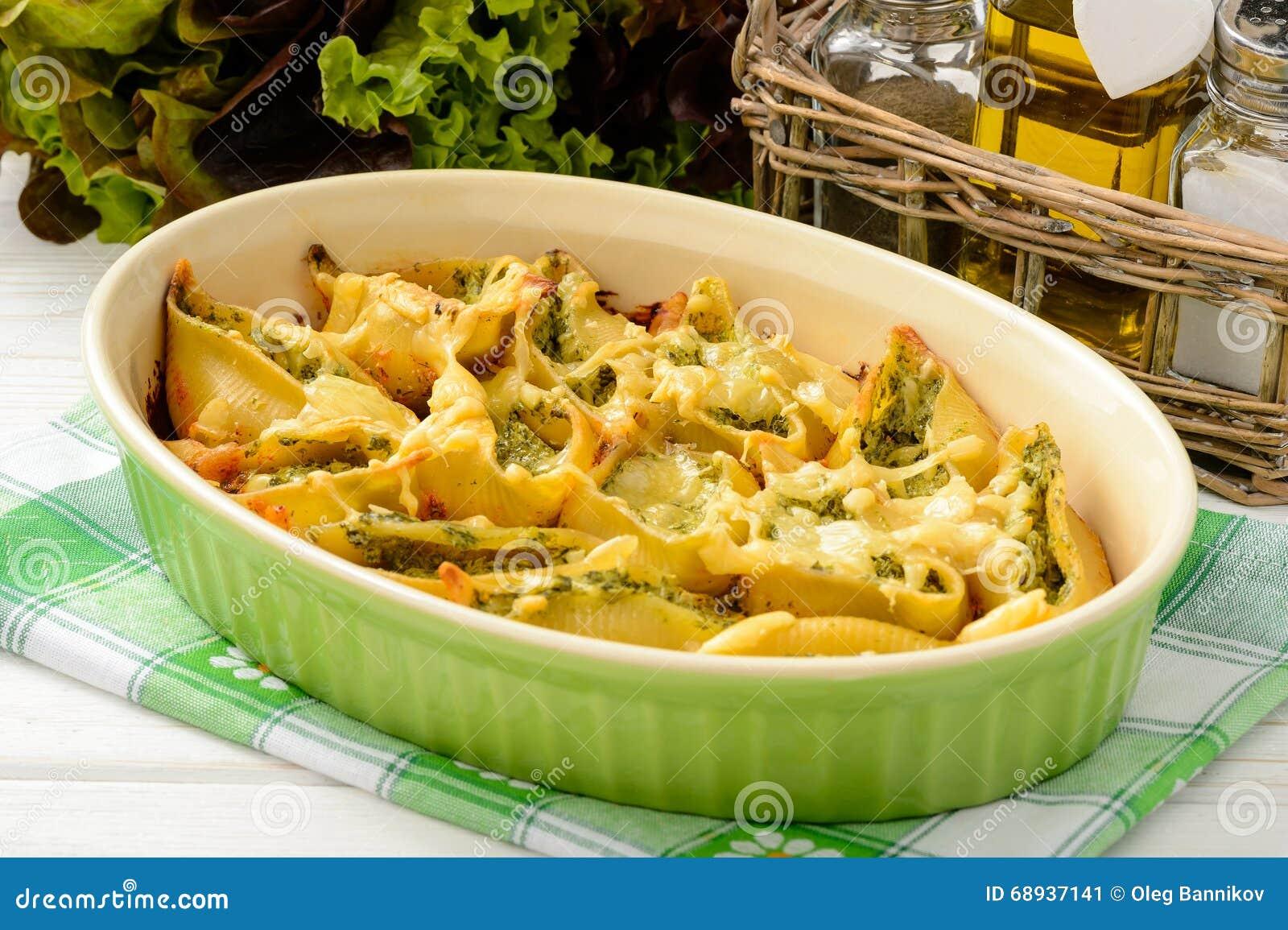 Italian cuisine pasta shells stuffed with spinach - Italian cuisine pasta ...