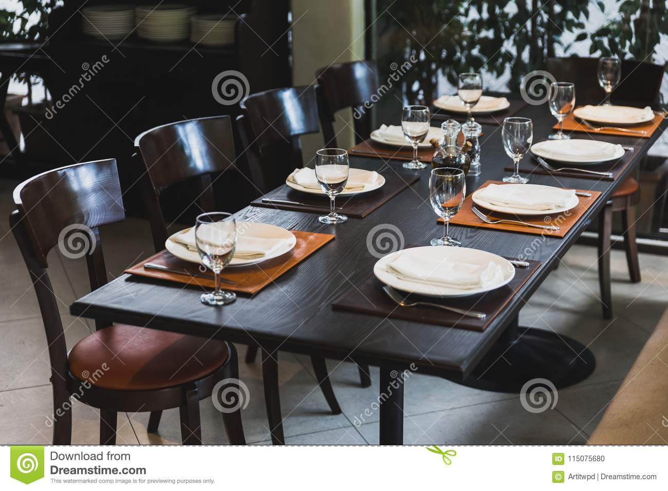 Italian Dinner Table For Eight With Cutleries, Plates, Glasses, Napkins And  Naperies On The Table.