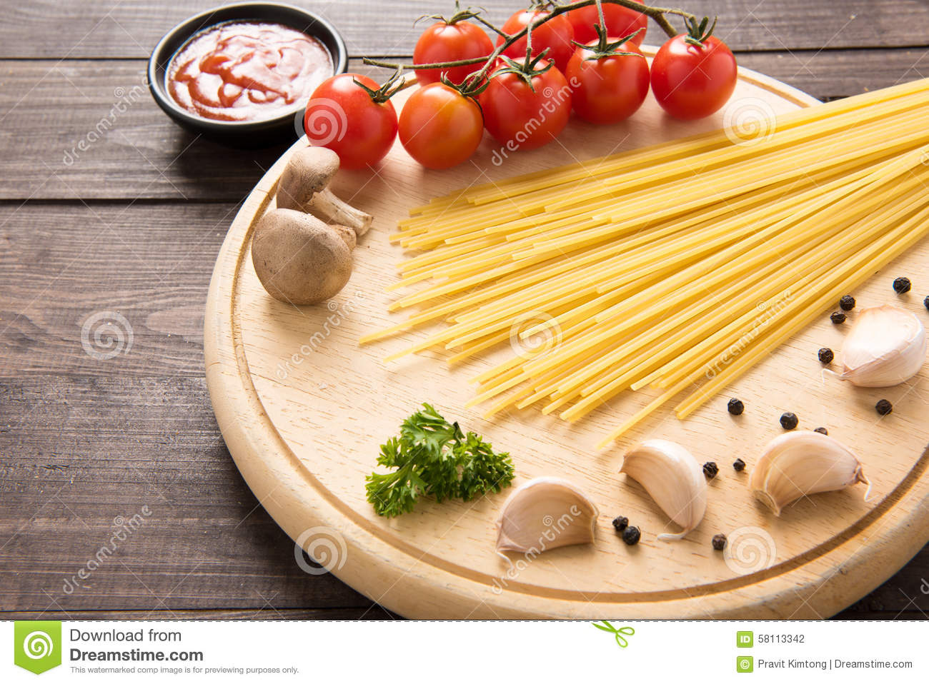 Italian food background with tomato garlic pepper for Cuisine wooden