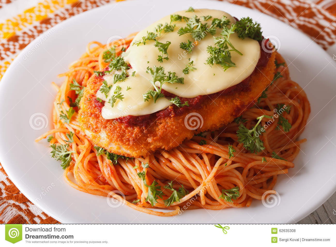 Italian food chicken parmigiana and spaghetti closeup for All about italian cuisine