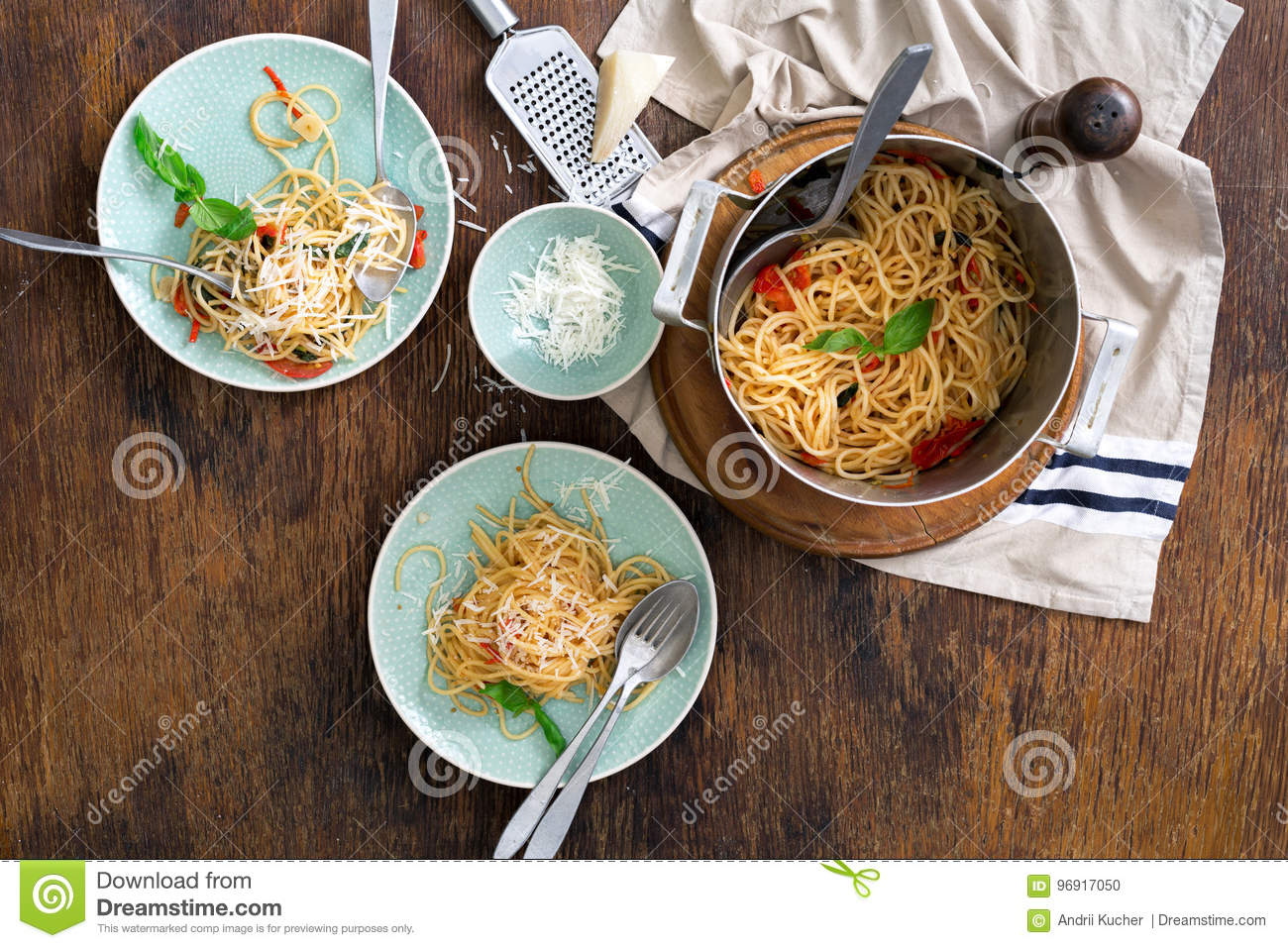 Classic Italian pasta with tomatoes on a wooden table