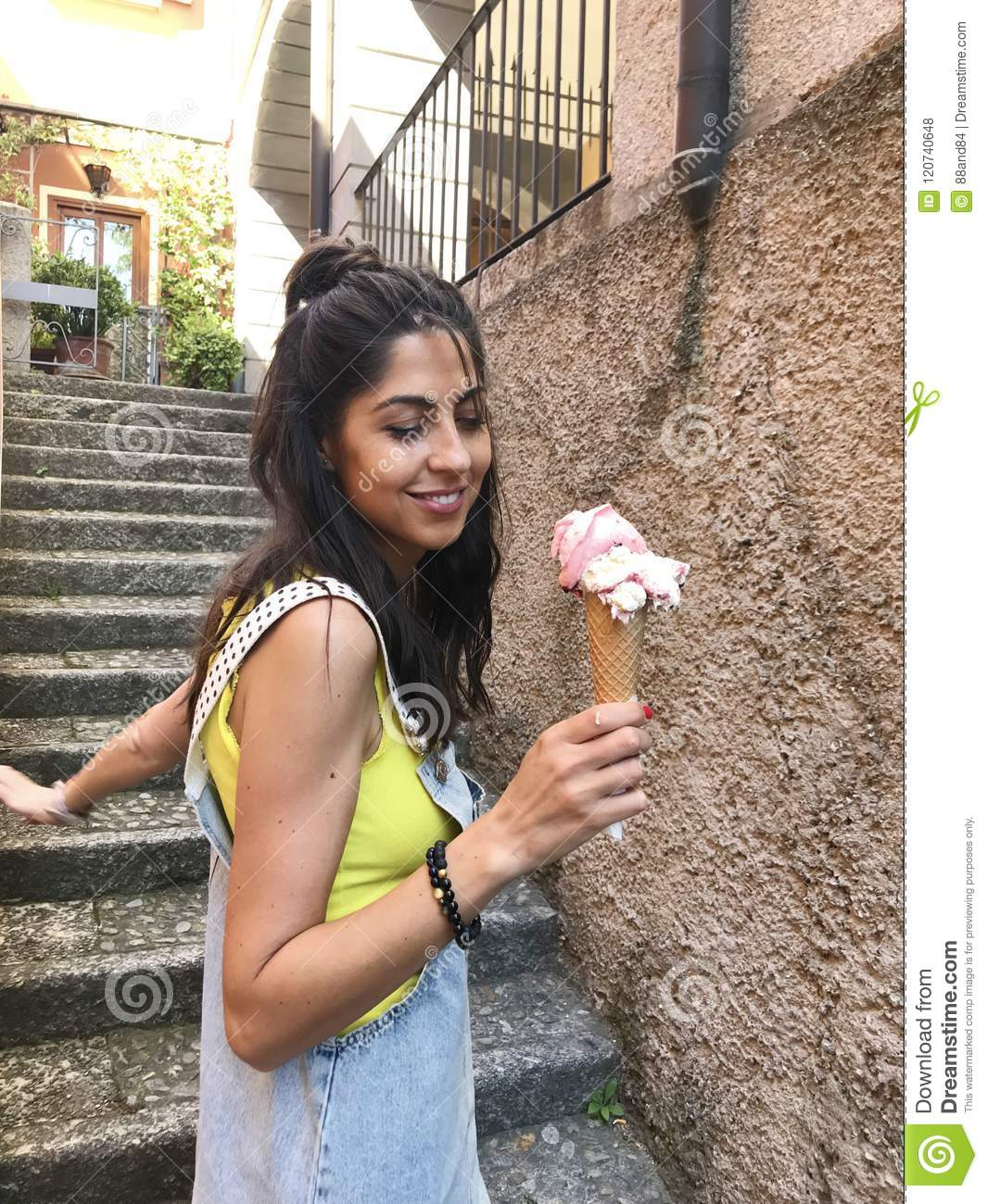 Woman Eating Ice Cream in Italy