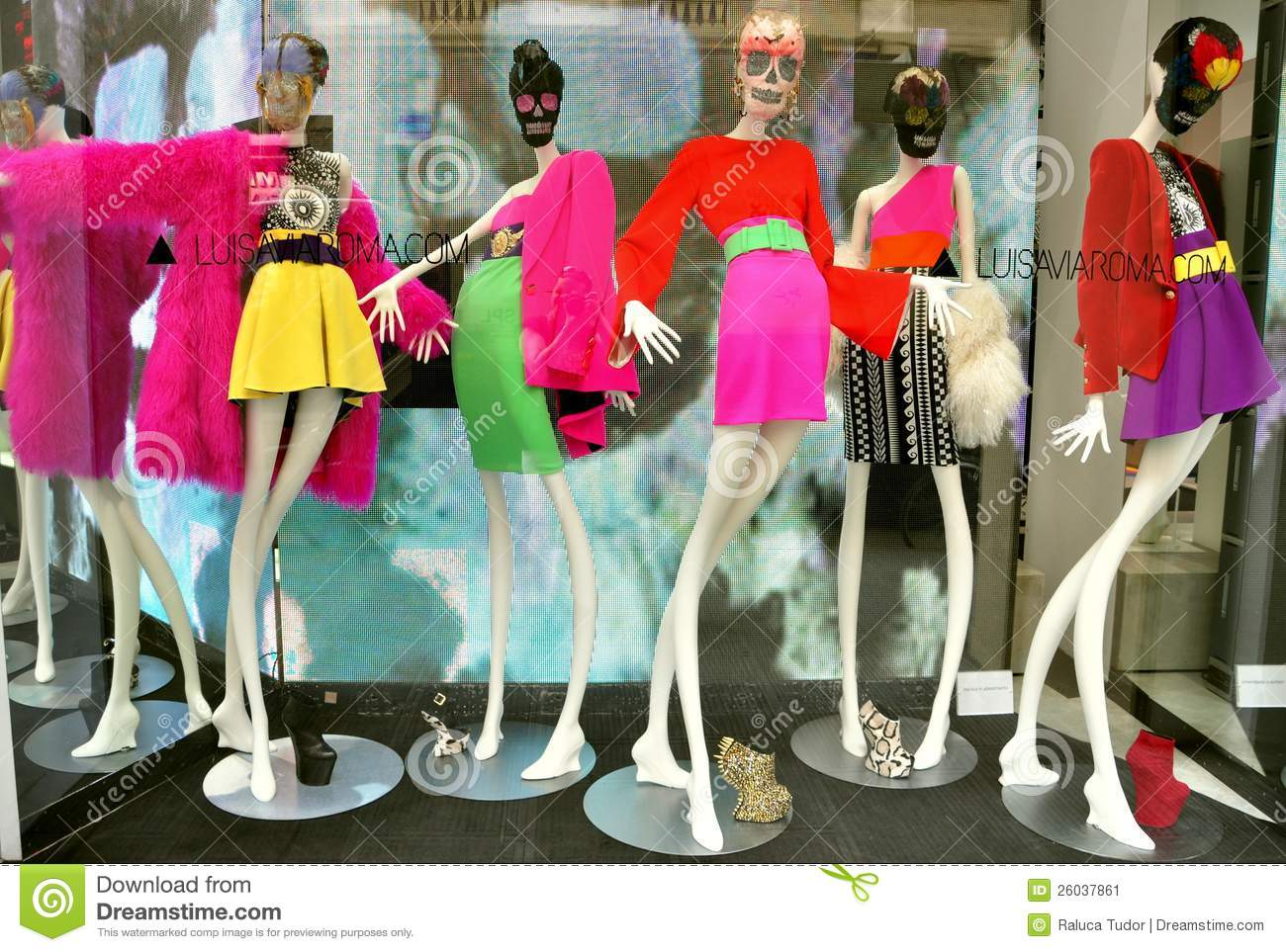 d57cea29510 Italian luxury fashion shop in Florence: Luisa Via Roma boutique with  manniquins dressed in colorful clothes .