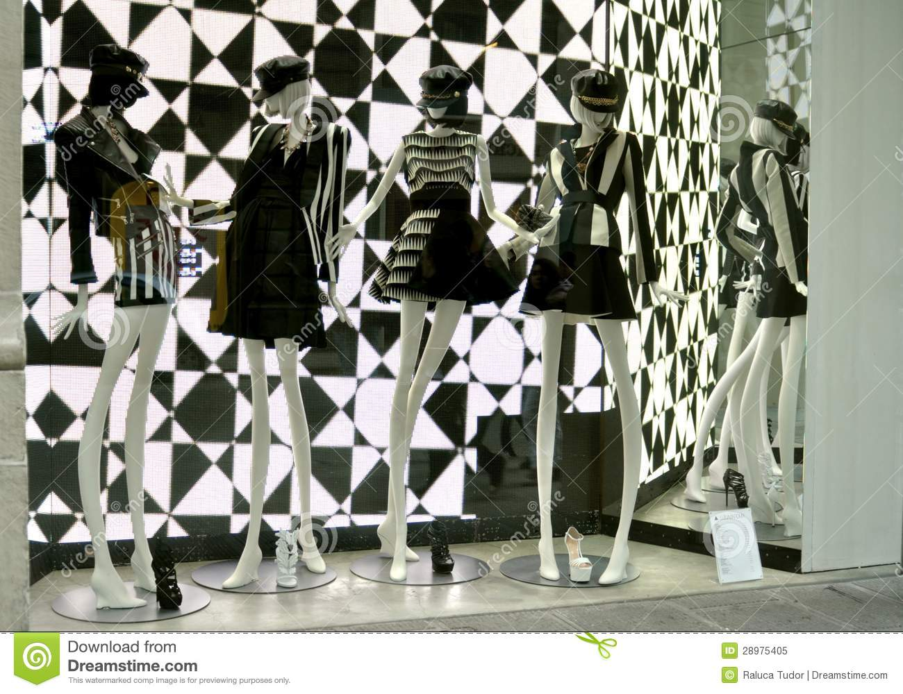 9d4b2c77ff2 Italian luxury fashion shop in Florence: Luisa Via Roma boutique with  manniquins dressed in black and white clothes .2013 spring fashion