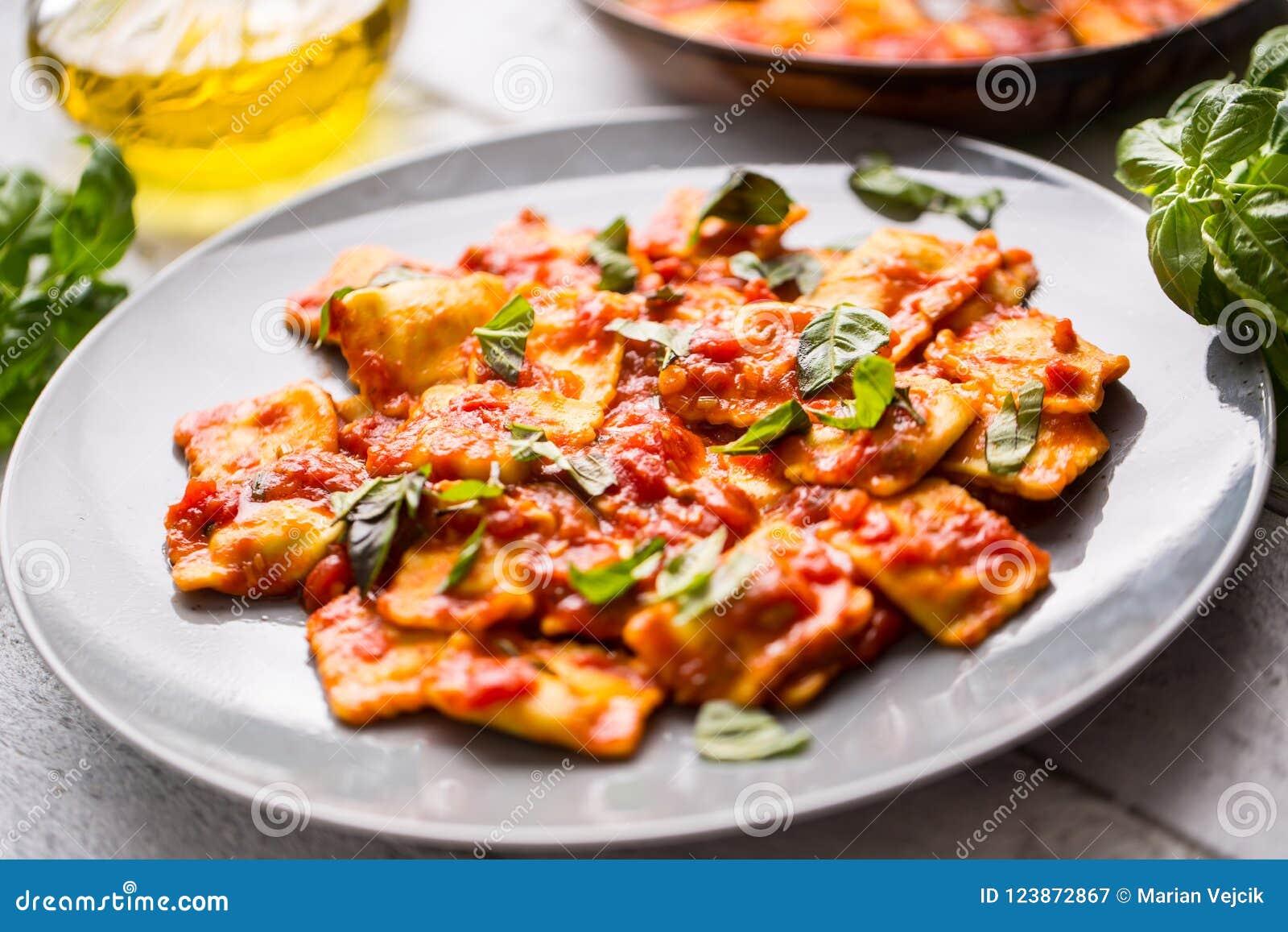 Italian or mediterranean food pasta ravioli of tomato sauce.