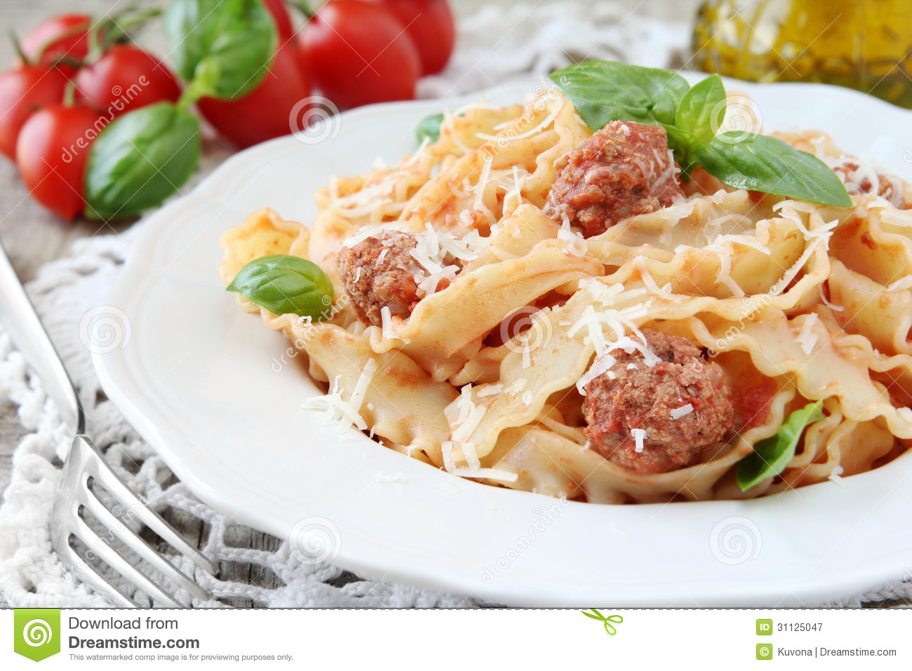 ... with tomato sauce, meatballs, fresh basil and grated parmesan cheese