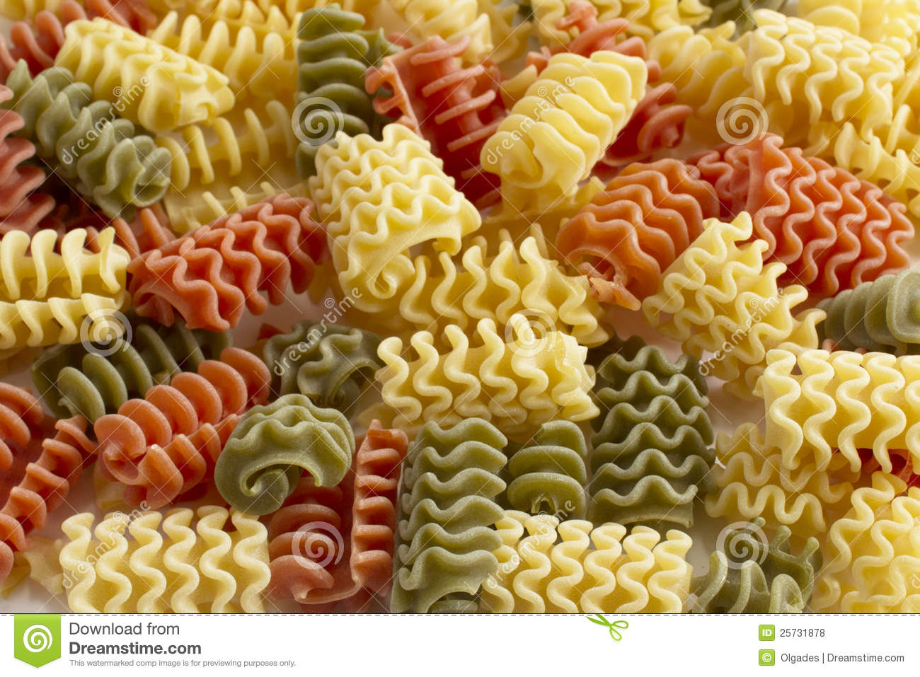 Italian pasta of spiral shaped on white