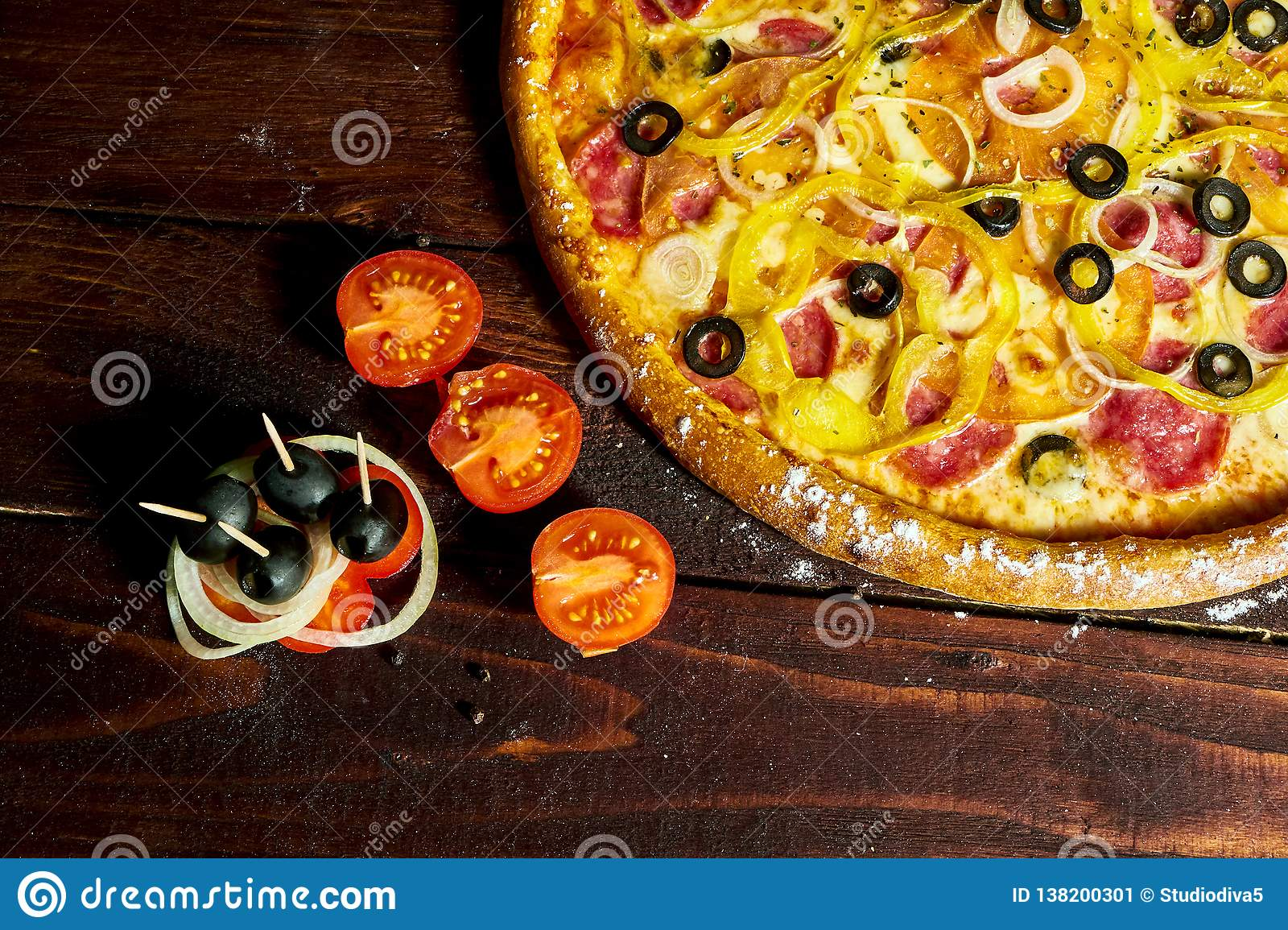 Italian pizza with olives cheese and salami