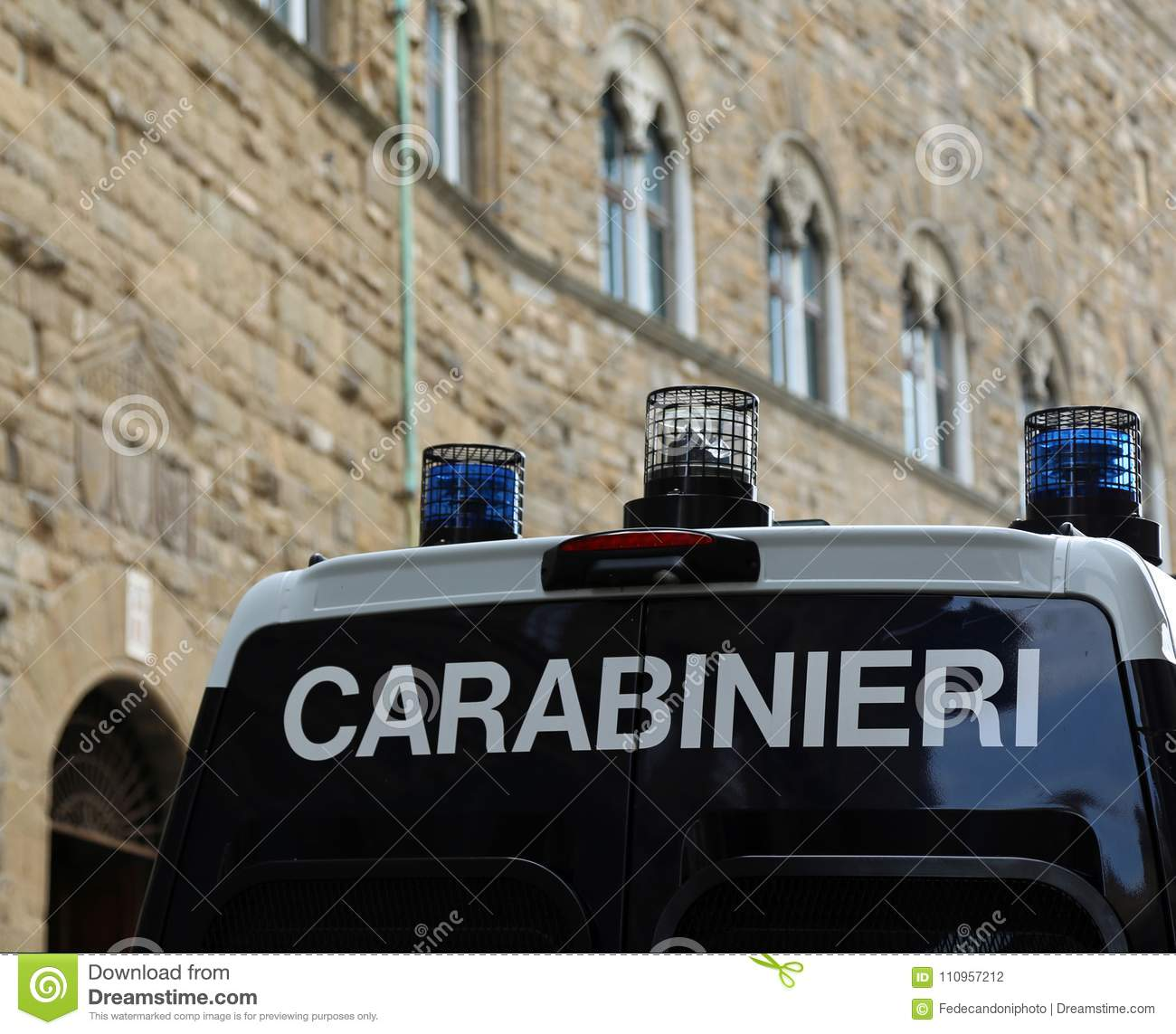 police van in a city during the protest demonstration. The italian police force is called CARABINIERI