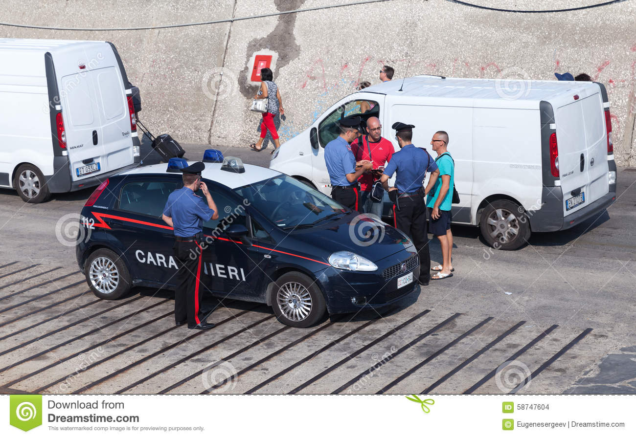 Italian Policemen Check Documents Of Men Editorial Stock Image